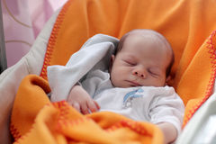 Newborn baby sleeping in the chair Stock Image