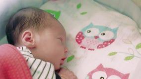 Newborn baby sleeping in the crib stock video