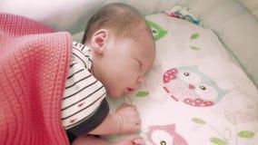 Newborn baby sleeping in the crib stock video footage