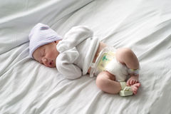 Newborn baby sleeping in hospital Stock Images