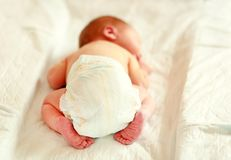 Newborn Baby Sleeping In A Diaper On A Changing Table. Royalty Free Stock Photos