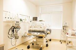 Newborn baby sleeping in an incubator in hospital Stock Photo