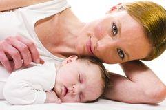 Newborn baby sleeping with mother Royalty Free Stock Photography