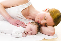 Newborn baby sleeping with mother Stock Photography