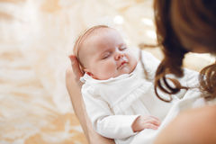 Newborn baby sleeping on mother's hands. Stock Image