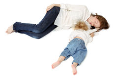 Newborn baby sleeping with mother. Two mother and the baby lying on the floor and sleep Stock Image