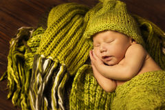 Newborn Baby Sleeping, New Born Kid Sleep in Green Woolen stock photo