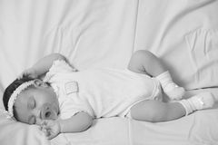 Newborn baby sleeping with a pacifier Stock Photo