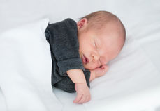 Newborn Baby sleeping peacefully in сrib Royalty Free Stock Image