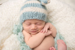 Newborn Baby Sleeping Smiling Stock Photography