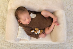 Newborn baby sleeping on soft couch Royalty Free Stock Photography