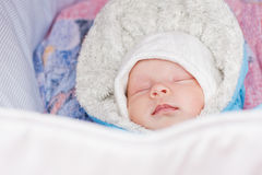 Newborn baby sleeping in a stroller Royalty Free Stock Photography