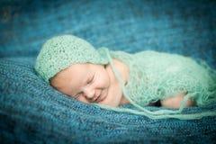 Newborn baby sleeping sweetly Stock Photos