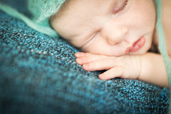 Newborn baby sleeping sweetly Stock Photography