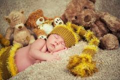Newborn baby sleeping on toys background. Stock Photo