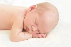 Newborn baby sleeping on white Stock Image
