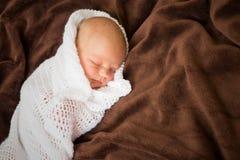 Newborn baby sleeping in white blanket. Newborn baby girl sleeping in white blanket Stock Photos