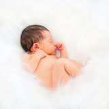 Newborn baby sleeping on the white. Blanket. Purity concept Stock Images