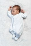 Newborn baby sleeping on white fur in  sunlight Stock Images
