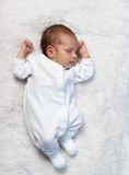 Newborn baby sleeping on white fur in  sunlight Royalty Free Stock Photography