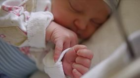 A newborn baby sleeps in the cradle. stock video footage