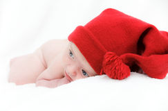 Newborn baby sleeps in a hat Royalty Free Stock Photography