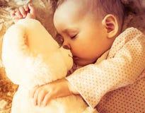 Newborn baby sleeps with a teddy bear Royalty Free Stock Photos
