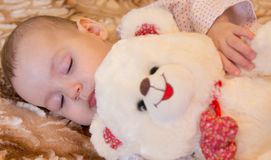 Newborn baby sleeps with a teddy bear Royalty Free Stock Images