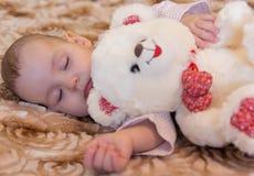 Newborn baby sleeps with a teddy bear Royalty Free Stock Photography