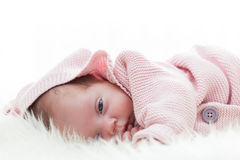 Newborn baby slepping on white fur blanket. Royalty Free Stock Photo