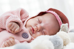 Newborn baby slepping on white fur blanket. Royalty Free Stock Images