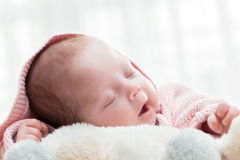 Newborn baby slepping on white fur blanket. Stock Photos