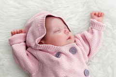 Newborn baby slepping on white fur blanket. Stock Photography