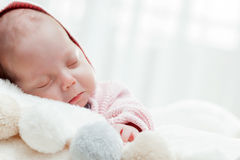 Newborn baby slepping on white fur blanket. Royalty Free Stock Photography
