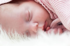 Newborn baby slepping on white fur blanket. Royalty Free Stock Photos