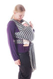 Newborn baby in sling Stock Photos