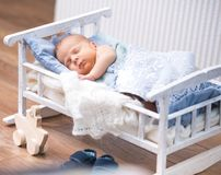 Newborn baby  in a small bed Royalty Free Stock Photography