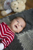 Newborn baby smiling Stock Photography