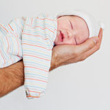 Newborn baby smiling in his sleep Stock Photo