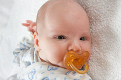 Newborn baby with soother Royalty Free Stock Photo