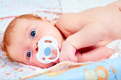 Newborn baby with soother Royalty Free Stock Image