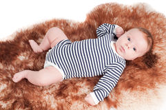 Newborn baby in striped body Royalty Free Stock Photo