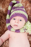Newborn baby in striped cap Royalty Free Stock Photos