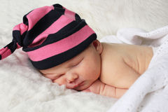 Newborn baby with stripy hat Royalty Free Stock Image