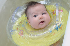 Newborn baby with swimming  circle smiling Royalty Free Stock Image