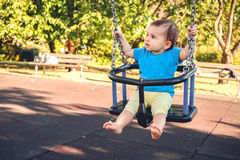 Newborn baby swing play park outdoor summer playground Stock Images