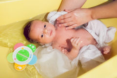 Newborn baby taking a bath Royalty Free Stock Images