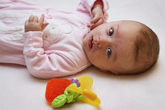 Newborn baby and teether Stock Photography