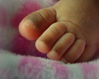 Newborn Baby Toes African American Stock Photos