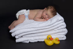 Newborn baby on top of towels. 11 days old newborn baby boy on top of bath towels Royalty Free Stock Photos